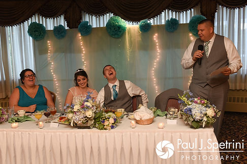 Neil and Gianna listen to the toasts during their July 2017 wedding reception at Quidnessett Country Club in North Kingstown, Rhode Island.