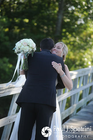 Laura and Laki share a hug during a first look prior to their September 2017 wedding ceremony at Lake of Isles Golf Club in North Stonington, Connecticut.