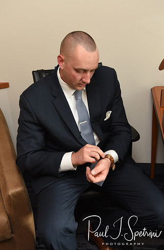 Mike puts his watch on prior to his May 2018 wedding ceremony at Bittersweet Farm in Westport, Massachusetts.