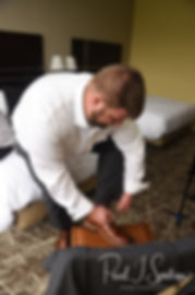Steve puts his shoes on prior to his October 2018 wedding ceremony at The Villa at Ridder Country Club in East Bridgewater, Massachusetts.