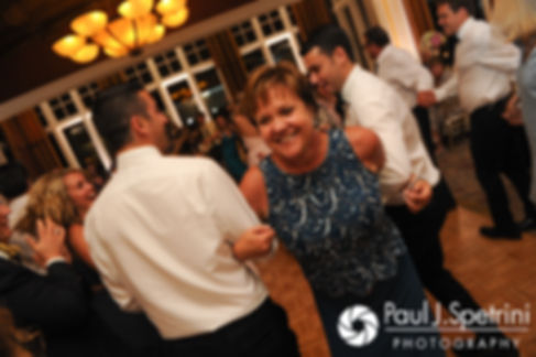 Guests dance during Laura and Laki's September 2017 wedding reception at Lake of Isles Golf Club in North Stonington, Connecticut.