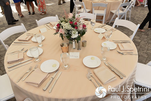 A look at the table decorations during Justin and Lauryn's July 2016 wedding reception at the Overlook at Geer Tree Farm in Griswold, Connecticut.