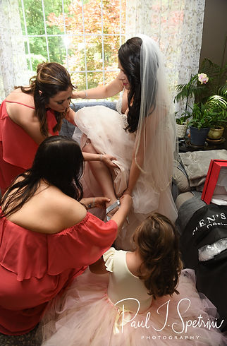 Stephanie has help putting her shoes on prior to her June 2018 wedding ceremony at Foster Country Club in Foster, Rhode Island.