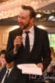 Joe's best man gives a speech during Kendra & Joe's May 2018 wedding reception at Crystal Lake Golf Club in Mapleville, Rhode Island.