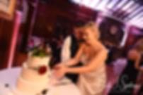 Meghan & Brian cut their wedding cake during their September 2018 wedding reception at Squantum Association in Riverside, Rhode Island.