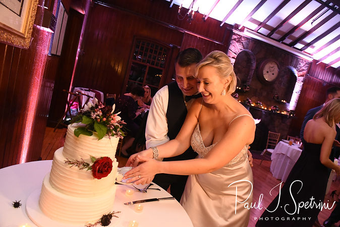 Meghan & Brian cut their wedding cake during their September 2018 wedding reception at Squantum Association in Riverside, Rhode Island.