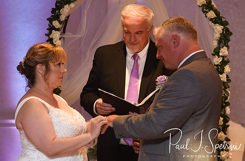 Robin puts a ring on Rick's hand during her August 2018 wedding ceremony at Twelve Acres in Smithfield, Rhode Island.
