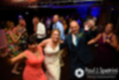 Kim dances with her parents during her August 2016 wedding at Whispering Pines Conference Center in West Greenwich, Rhode Island.