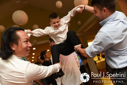 Guests have fun during Kelly and Brian's November 2016 wedding reception at the Bay Pointe Club in Buzzards Bay, Massachusetts.