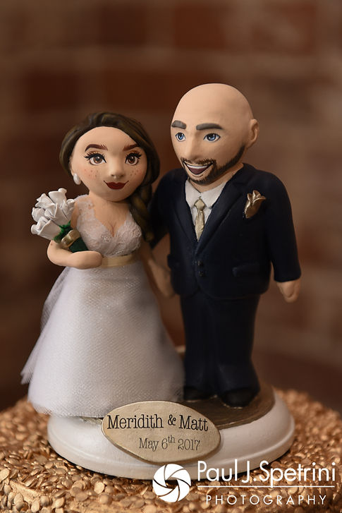 Meridith and Matthew's wedding cake toppers were shaped in their likeness and are on display following their May 2017 wedding ceremony at the Hope Artiste Village in Pawtucket, Rhode Island.