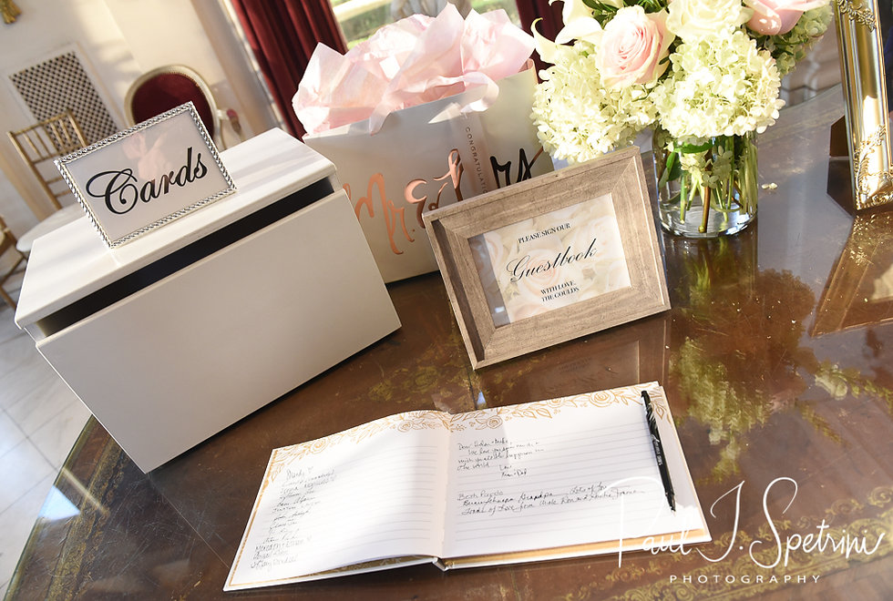 A look at the guestbook, shown on display during Helen & Mike's September 2018 wedding reception at the Rosecliff Mansion in Newport, Rhode Island.