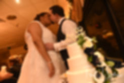 Gunnar & Aileen kiss after cutting their wedding cake during their December 2018 wedding reception at McGoverns on the Water in Fall River, Massachusetts.