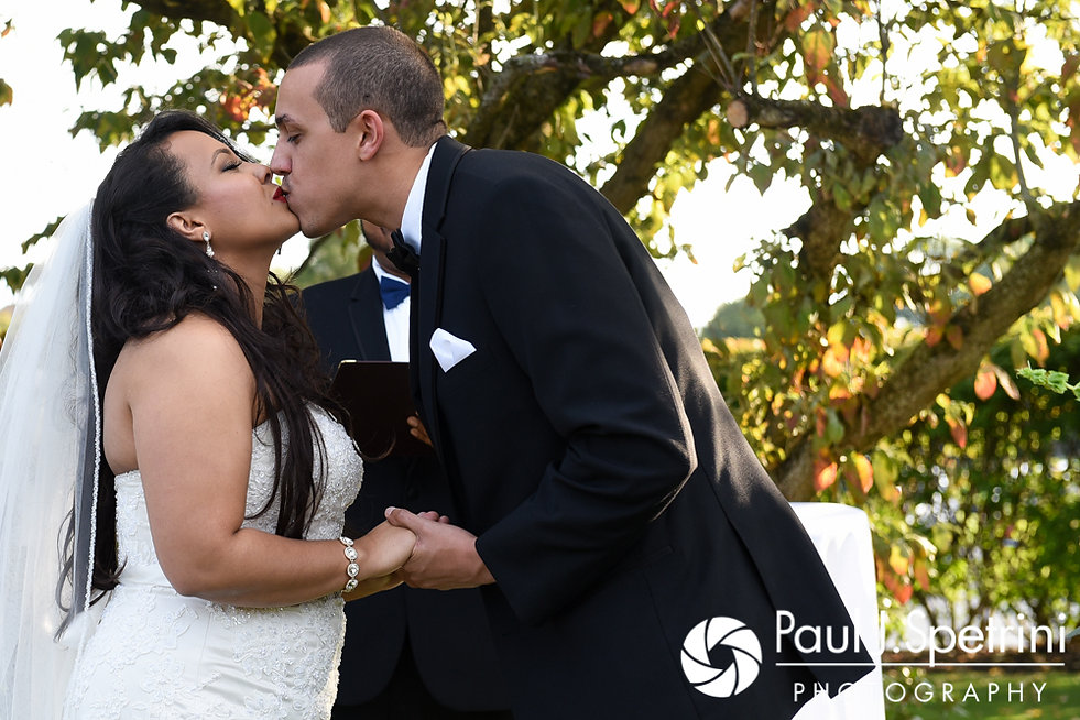 Stephany and Arten share their first kiss as husband and wife during their September 2017 wedding ceremony at Wannamoisett Country Club in Rumford, Rhode Island.