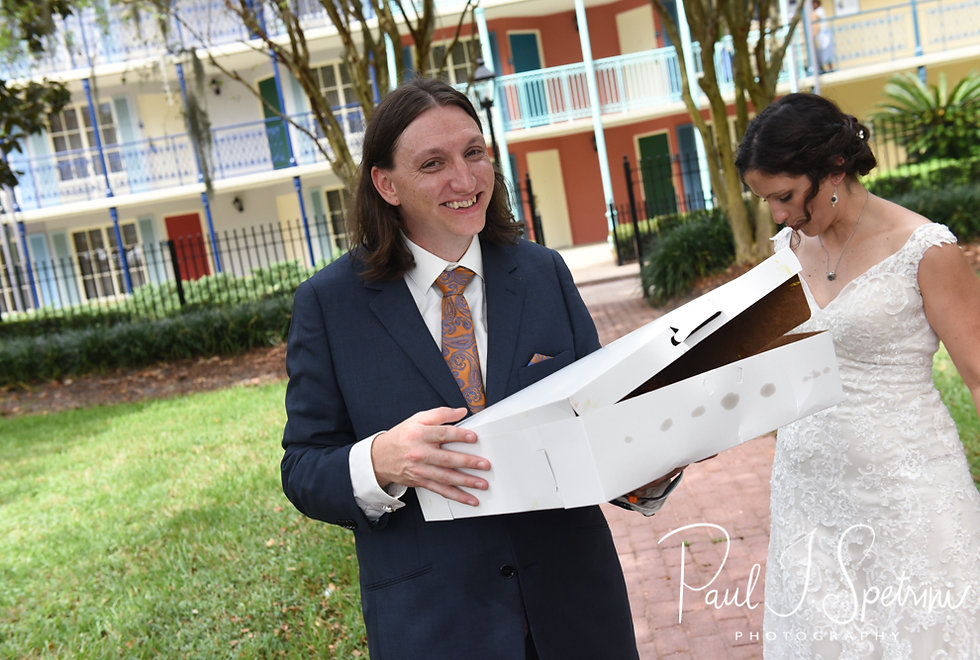 Josh holds a box of cupcakes following his October 2018 wedding ceremony at the Walt Disney World Swan & Dolphin Resort in Lake Buena Vista, Florida.