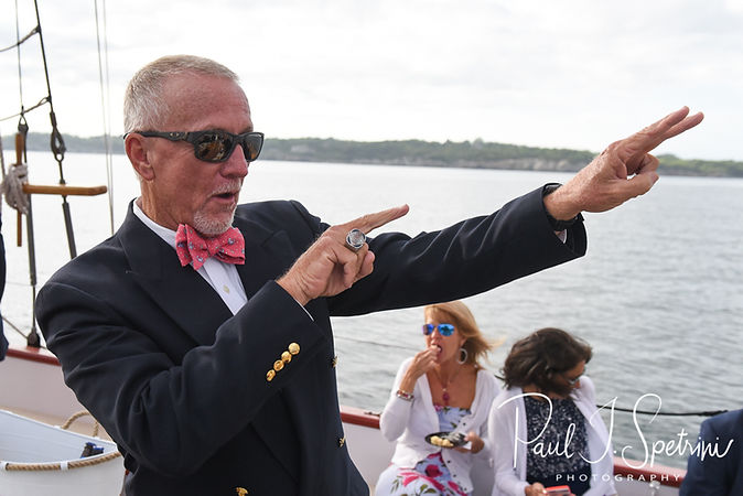 Mike signals to Kate during his May 2018 wedding ceremony aboard the Schooner Aurora boat in the waters off Newport, Rhode Island.