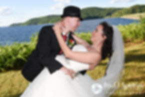 Amanda and Chris smile for a photo following their summer wedding near the Quabbin Reservoir in Belchertown, Massachusetts on July 2nd, 2016.