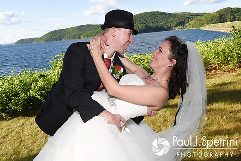 Amanda and Chris smile for a photo following their summer wedding near the Quabbin Reservoir in Belchertown, Massachusetts on July 2nd, 2016.