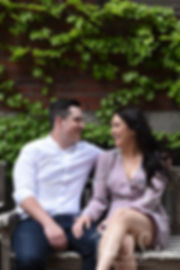 Nicole and Dan talk during a photo in the North End neighborhood of Boston, Massachusetts during their May 2018 engagement session.