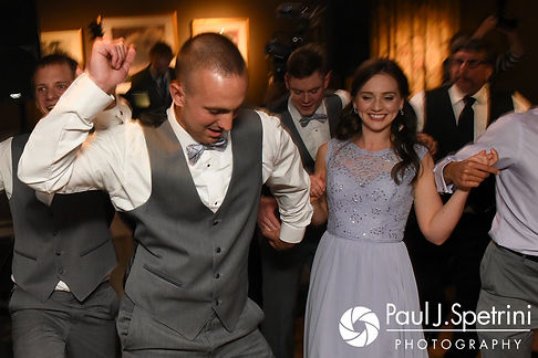 Guests dance during Melissa and Jordan's May 2017 wedding reception at Independence Harbor in Assonet, Massachusetts.