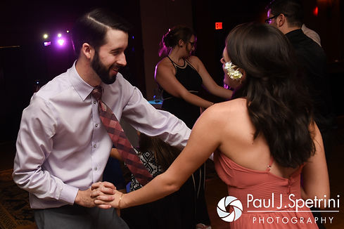 Guests dance during Kristin and Chris' October 2016 wedding reception at the Ashworth by the Sea Hotel in Hampton, New Hampshire.