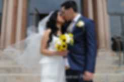 Keirys and Jhair share a kiss during the May 2015 wedding.