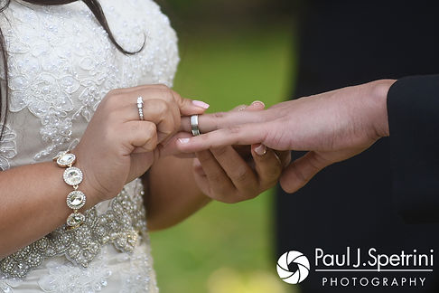 Arten and Stephany exchange rings during their September 2017 wedding ceremony at Wannamoisett Country Club in Rumford, Rhode Island.