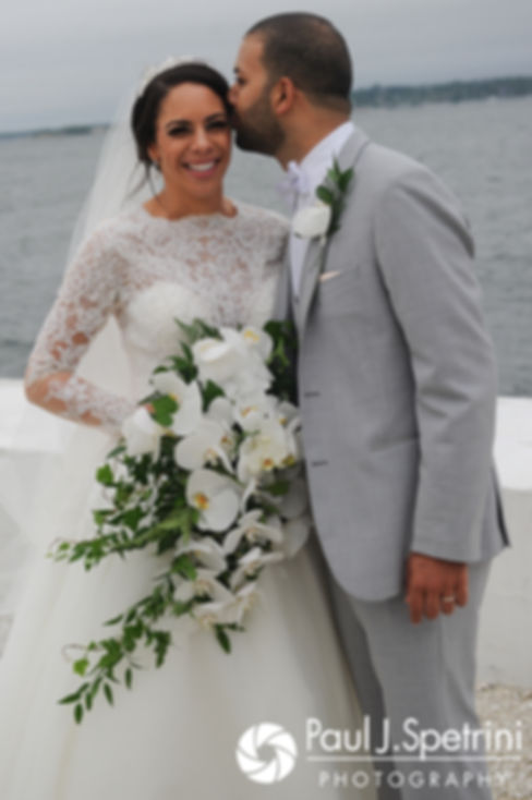 Nashua and Nader kiss during formal photos following their July 2017 wedding ceremony at Belle Mer in Newport, Rhode Island.