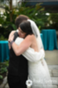 Jen and Kyle hug following a special first look prior to their September 2016 wedding at the Roger Williams Park Botanical Center in Providence, Rhode Island.