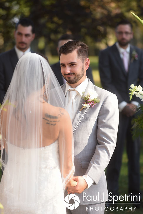 John smiles while looking at Stacey during his September 2017 wedding ceremony at Colt State Park in Bristol, Rhode Island.