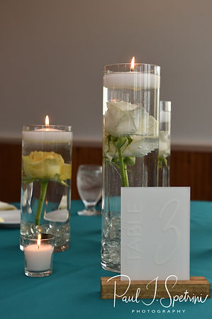 A look at the centerpieces during Amber & Justin's June 2018 wedding reception at North Beach Clubhouse in Narragansett, Rhode Island.