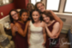 Courtnie poses for a photo with her bridesmaids prior to her August 2018 wedding ceremony at Glad Tidings Church in Quincy, Massachusetts.