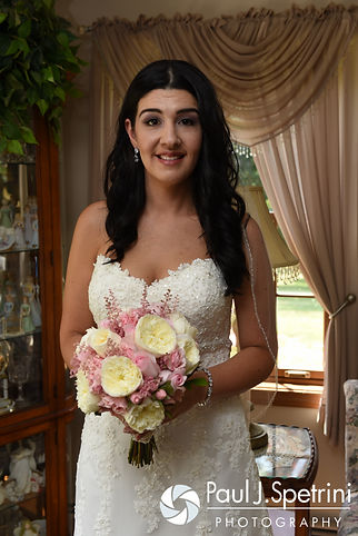 Lauryn smiles for a photo prior to her July 2016 wedding at St. Paul the Apostle Catholic Church in Foster, Rhode Island.