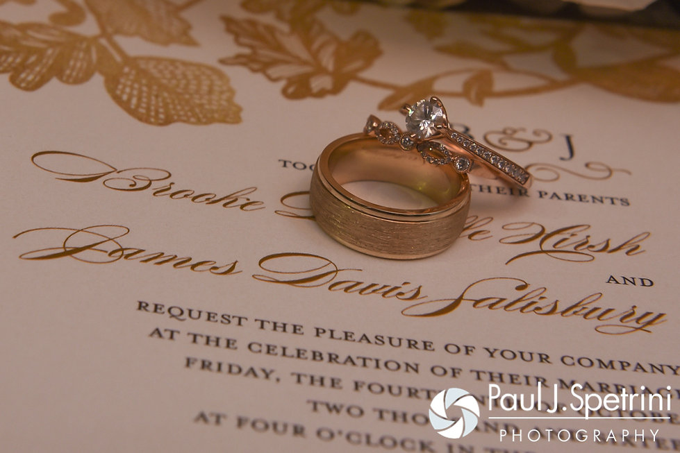 A look at JD and Brooke's wedding rings and invitation, on display during their October 2016 wedding reception at The Farm at SummitWynds in Jefferson, Massachusetts.