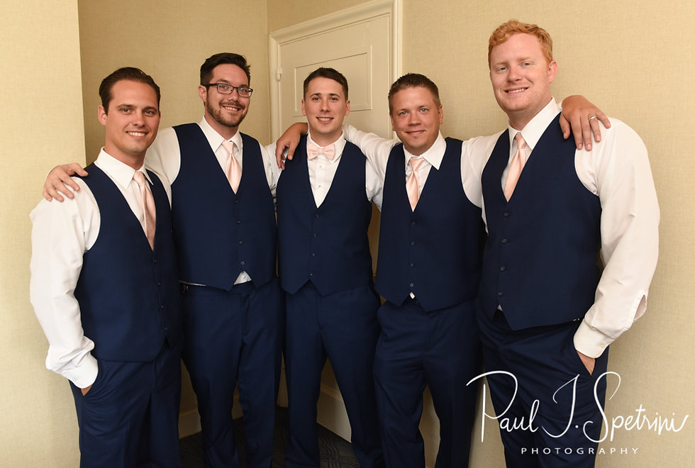 Michael poses for a photo with his groomsmen at the hotel prior to his August 2018 wedding ceremony at the Squantum Association in Riverside, Rhode Island.