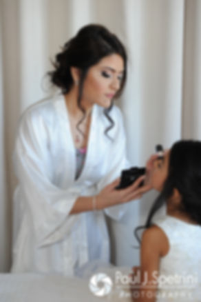 Maria applies makeup to her flower girl prior to her March 2016 Rhode Island wedding.