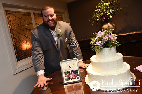 Jordan poses for a photo near his wedding cake during his May 2017 wedding reception at Independence Harbor in Assonet, Massachusetts.