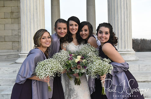 Stacey poses for a formal photo with her bridesmaids at Roger Williams Park in Providence, Rhode Island prior to their December 2018 wedding reception at Independence Harbor in Assonet, Massachusetts.