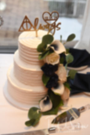 A look at the wedding cake during Gunnar & Aileen''s December 2018 wedding reception at McGoverns on the Water in Fall River, Massachusetts.