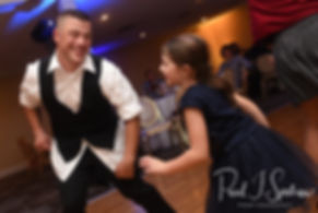 Guests dance during Chris & Stephanni's October 2018 wedding reception at Rachel's Lakeside in Dartmouth, Massachusetts.