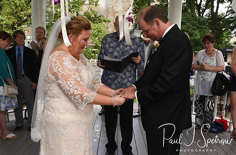 Patti and Bob hold hands during their August 2018 wedding ceremony at the Walter J. Dempsey Memorial Bandstand in Norwood, Massachusetts.