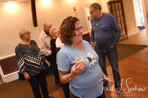 Amanda's mom holds a cupcake during Amanda & Josh''s October 2018 wedding reception at Loon Pond Lodge in Lakeville, Massachusetts.