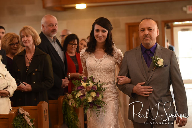 Stacey walks down the aisle with her dad during her December 2018 wedding ceremony at St. Teresa's Church in Attleboro, Massachusetts.