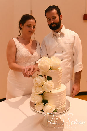Mike & Selah cut their wedding cake during their August 2018 wedding reception at The Rotunda Ballroom at Easton's Beach in Newport, Rhode Island.