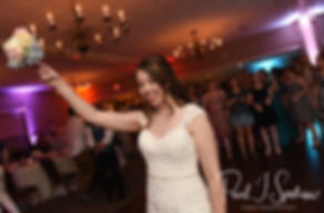 Sarah throws her bouquet during her June 2018 wedding ceremony at the College of the Holy Cross in Worcester, Massachusetts.