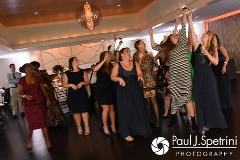 Wedding guests vie for the bouquet during Kevin and Kristina's October 2017 wedding reception at the Villa Ridder Country Club in East Bridgewater, Massachusetts.