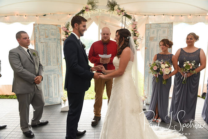 Karolyn and Ethan exchange rings during their August 2018 wedding ceremony at a private residence in Sterling, Connecticut.