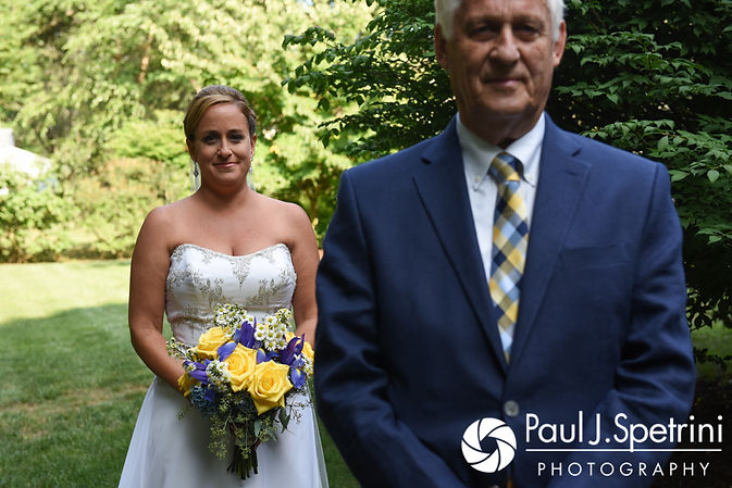 Rebecca stands behind her father for a first look prior to her August 2017 wedding ceremony in Warwick, Rhode Island.