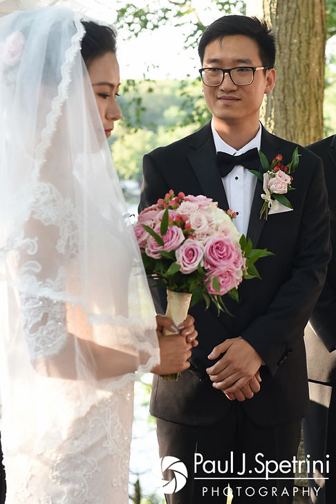 Ao looks at Cynthia during his August 2017 wedding ceremony at Lake Pearl in Wrentham, Massachusetts.