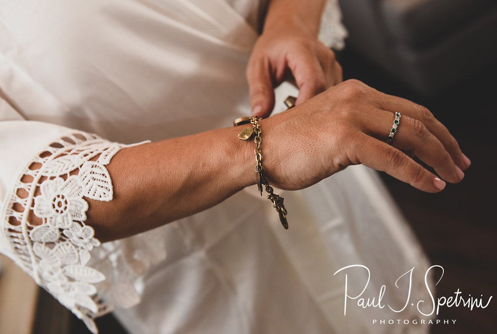 Kate adjusts her jewelry prior to her May 2018 wedding ceremony aboard the Schooner Aurora boat in the waters off Newport, Rhode Island.