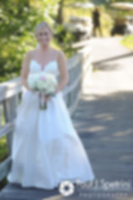 Laura arrives for her and Laki's first look prior to their September 2017 wedding ceremony at Lake of Isles Golf Club in North Stonington, Connecticut.